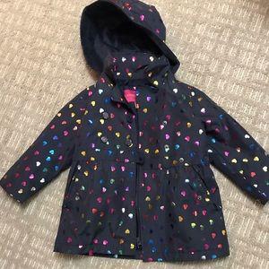 Little girl lined London fog rain coat
